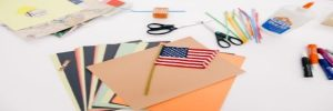 A desk with office supplies and an American flag
