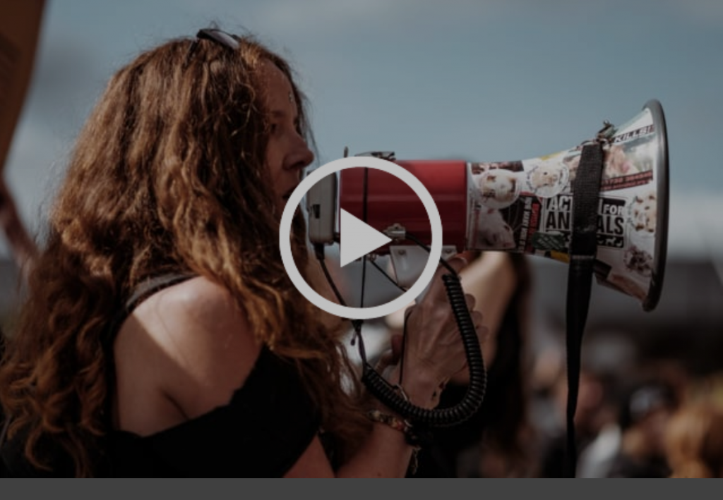 Video still of woman with megaphone