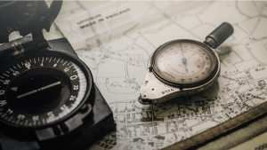 A photo of a map and compass