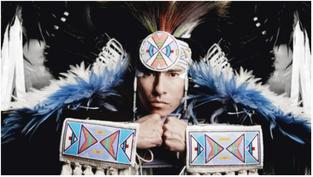 "Supaman is a Native American dancer and innovative hip-hop artist who has ""dedicated his life to empowering and spreading a message of hope, pride and resilience through his original art form."""